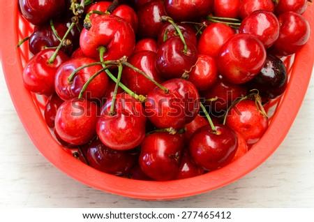 A basket of organically grown bing cherries in a local fruit market at Ellensburg, Washington, US - stock photo