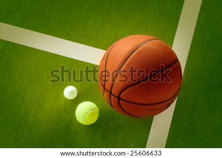 A basketball, a tennis ball and a Ping-Pong ball on the green background - stock photo