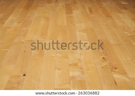 A basketball court floor made of maple hardwood viewed at a low angle - stock photo