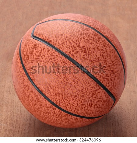 A basketball on a hardwood court floor viewed from above sport and exercise, leisure activities, team players with dribbling and passing the ball in a competitive match. - stock photo