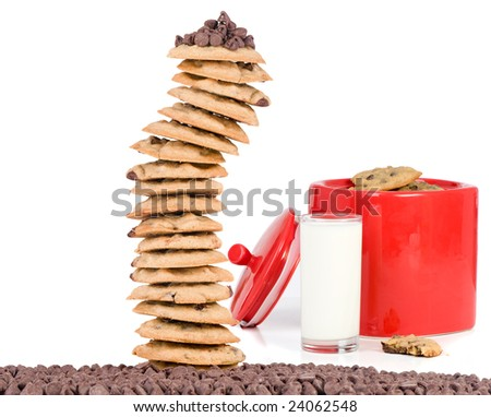 A batch of fresh chocolate chip cookies in a bright red Jar. - stock photo