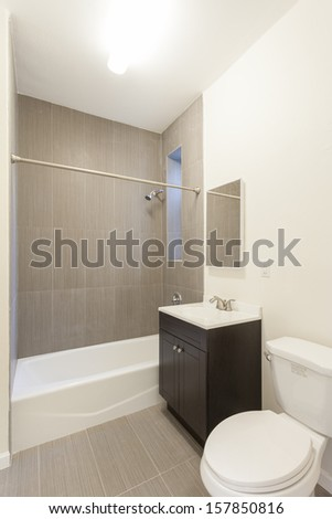 A bathroom in a studio apartment.