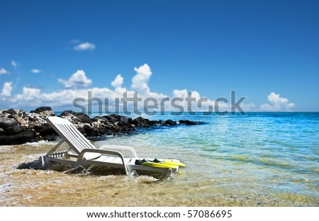 a Beach chair on a tropical island beach - stock photo