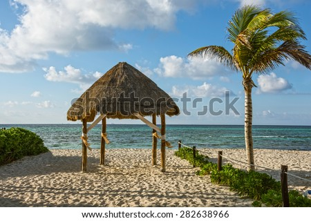 A beach hut on the sand along the coastline in Playa Del Carmen in Mexico. - stock photo