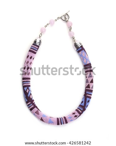 A beaded necklace. Isolated on white background - stock photo