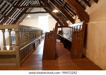 A beamed ceiling upstairs in a church - stock photo