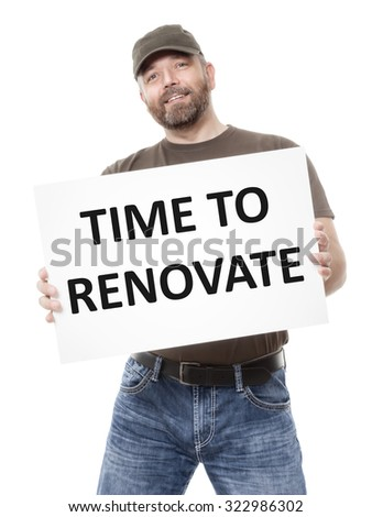A bearded man holding a white board with the message time to  renovate - stock photo