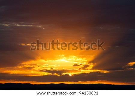 A beautiful african sunset with bright colors and the rays of the sun above the horizon