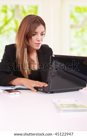 A Beautiful and sexy businesswoman in her office