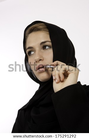 A Beautiful Arab Student Brainstorming - stock photo