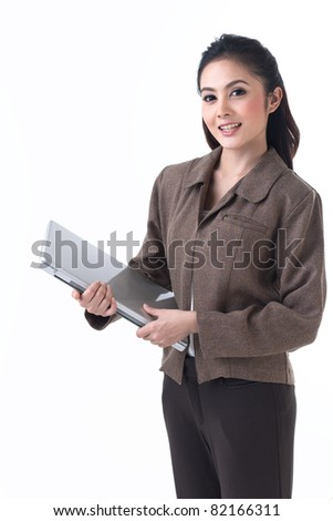 A beautiful asian business woman standing with laptop - stock photo