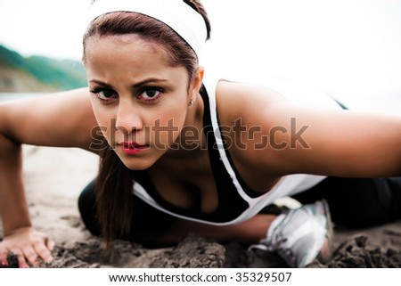 A beautiful asian woman exercises in a park - stock photo