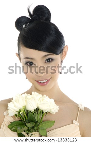 A beautiful asian woman poses in her  gown - stock photo