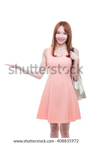 A beautiful asian woman with bag isolated on white background. - stock photo