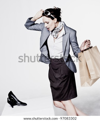 A beautiful attractive woman shopping for new shoes - stock photo