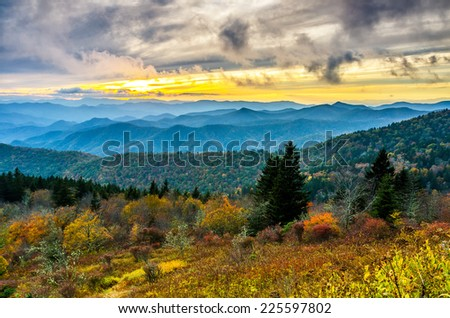 A beautiful autumn sunset over Cowee Mountain in the Great Smoky Mountains as seen from the Blue Ridge Parkway in North Carolina. - stock photo