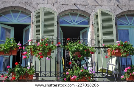 A beautiful balcony on a riverside house in the medieval town of Dinan in Brittany, France