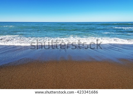 A beautiful beach, blue sky, sparkling sea, soothing sand, the perfect location for doing zen, yoga, zumba, or just relaxing, located on the Big Sur coastline, on the California. Central Coast. - stock photo