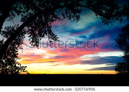 A beautiful big sky sunset.  Shot on Southern Alberta prairies, Canada. - stock photo