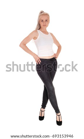 A beautiful blond woman in a white t-shirt and black jeans standing