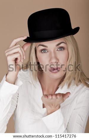 A beautiful blond woman wearing a bowler hat. Beautiful woman. - stock photo