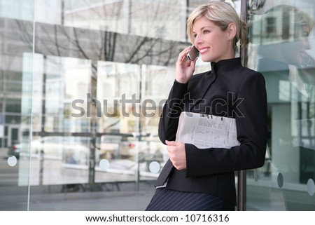 A beautiful blonde business woman on the phone