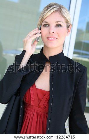 A beautiful blonde business woman on the phone - stock photo