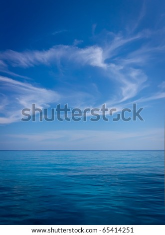 a beautiful blue sky with clouds and turquoise ocean - stock photo