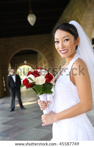 A beautiful bride  church during wedding with man groom in background - stock photo