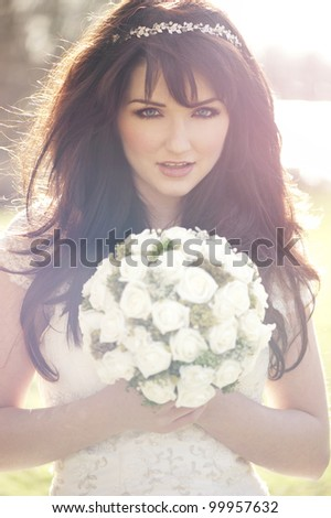 A beautiful bride outdoors. Vintage effect. - stock photo