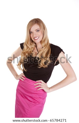 A beautiful business woman in her bright pink skirt showing her happy expression. - stock photo