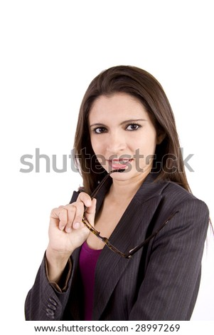 A beautiful businesswoman is biting down on a glasses and giving a forth coming look.