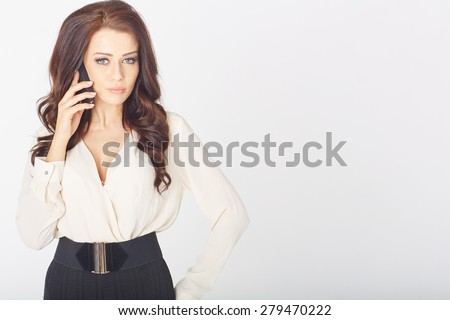a beautiful Businesswoman with cellphone in a white studio