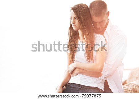 A beautiful caucasian couple in love on the beach - stock photo