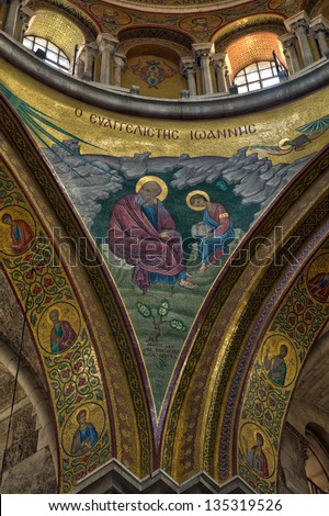 A beautiful christian mosaic on the lower part of the smaller dome at the Basilica of the Church of the Holy Sepulchre, in the old city of Jerusalem, Israel. - stock photo