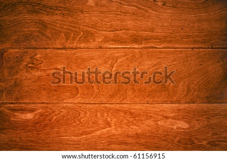 A beautiful deep, rich hardwood floor with its wood grain details for use as and background or appropriate housing inference. - stock photo