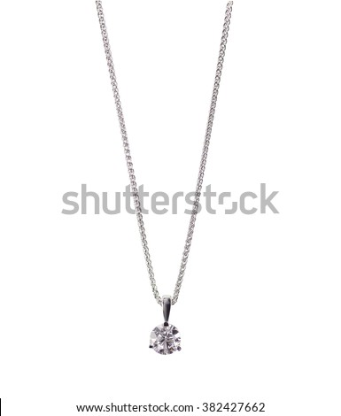 A beautiful diamond and white gold pendant dangles from a chain. Fine Jewelry necklace isolated on a white background with shadow and reflection - stock photo