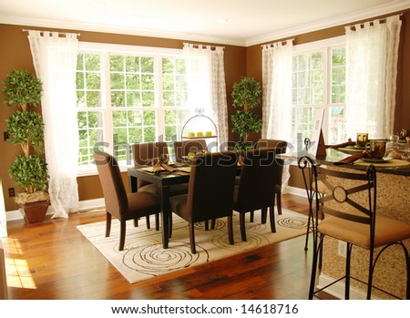 A beautiful dinning room with lots of natural light - stock photo