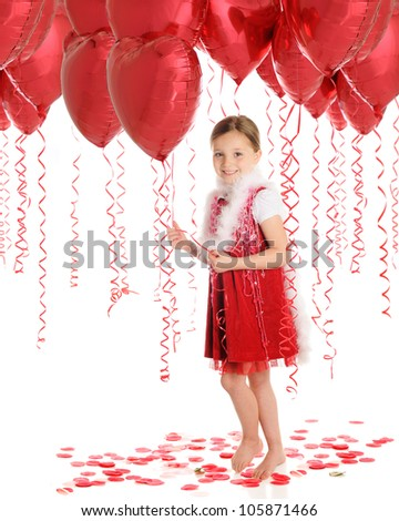 A beautiful elementary girl walking through a forest of heart shaped balloons.  On a white background. - stock photo
