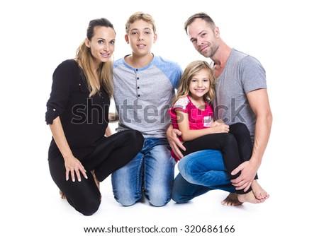 A beautiful family on studio white background - stock photo