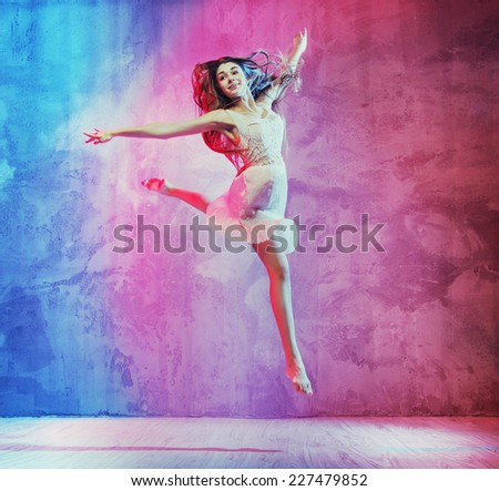 A beautiful female ballet dancer - stock photo