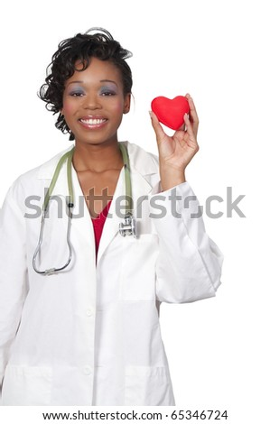 A beautiful female doctor in a lab coat holding a heart - stock photo