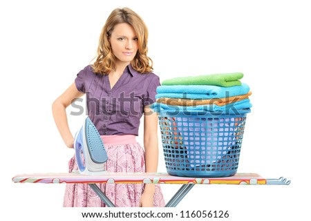 A beautiful female posing after ironing clothes isolated on white background - stock photo