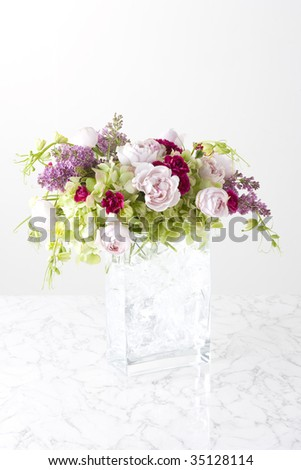 A beautiful flower arrangement isolated on white - stock photo