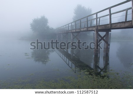 A beautiful foggy morning in the Netherlands - stock photo