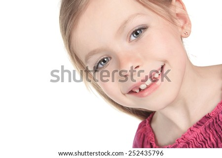 A beautiful girl child over a white background. - stock photo