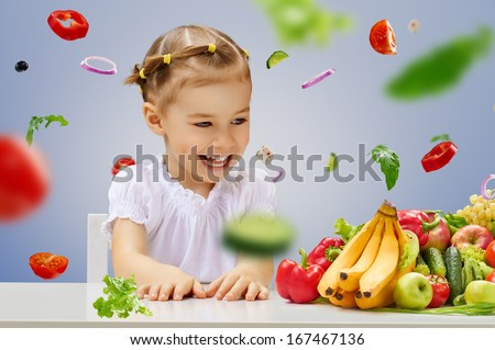 A beautiful girl eating fresh fruit - stock photo