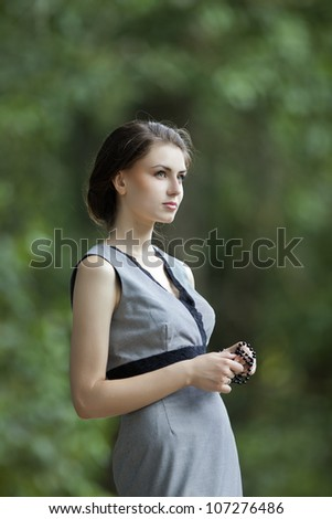 a beautiful girl in an outdoor shooting - stock photo