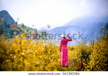 A beautiful girl in Ao dai,Vietnamese Dress at Sa-pa, Vietnam