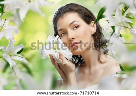 a beautiful girl in the flower garden - stock photo